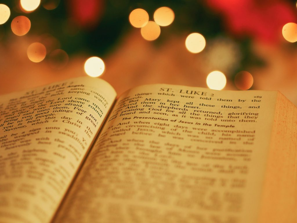 photo of bible opened to luke chapter 2 - True Meaning Of Christmas